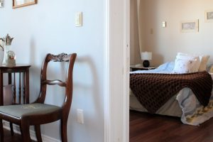 Shot of the threshold between the living and bedroom areas of the 1-bedroom suite at Riverview