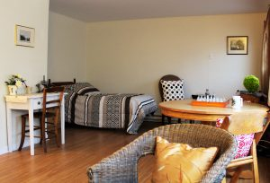 A wide shot showcasing the studio 5 suite at Riverview.