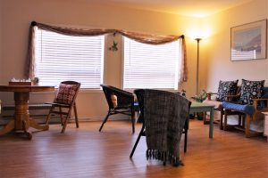 An image showcasing the livingroom portion of the studio 5 suite at Riverview