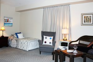 A bed facing shot of the studio 7 suite at Riverview